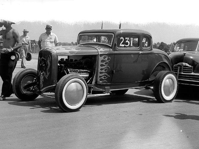 0710sr_04_z+1932_ford_five_window_highboy_coupe+front_left_view.jpg