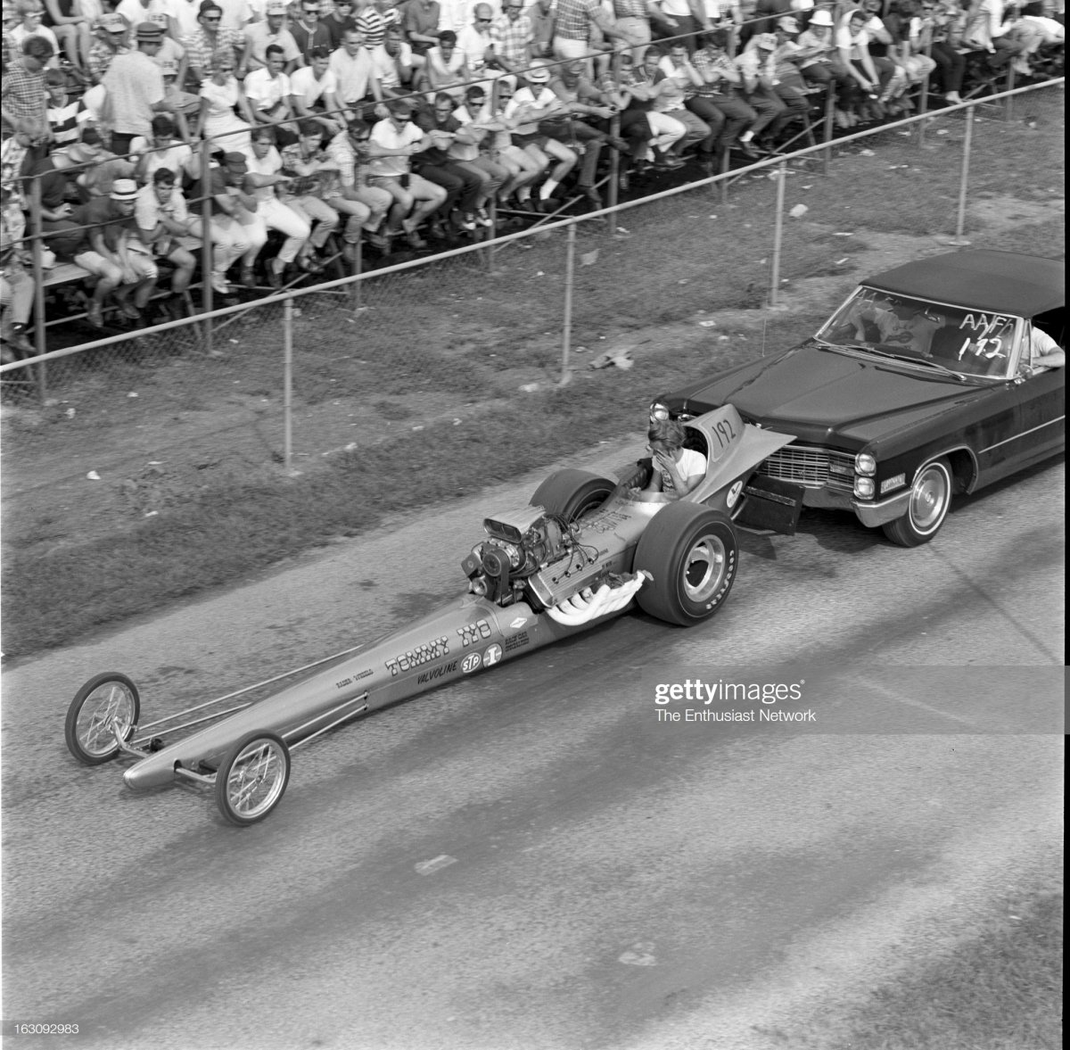 1  Tommy Ivo With Dragster pushed by caddy back to pits.jpg