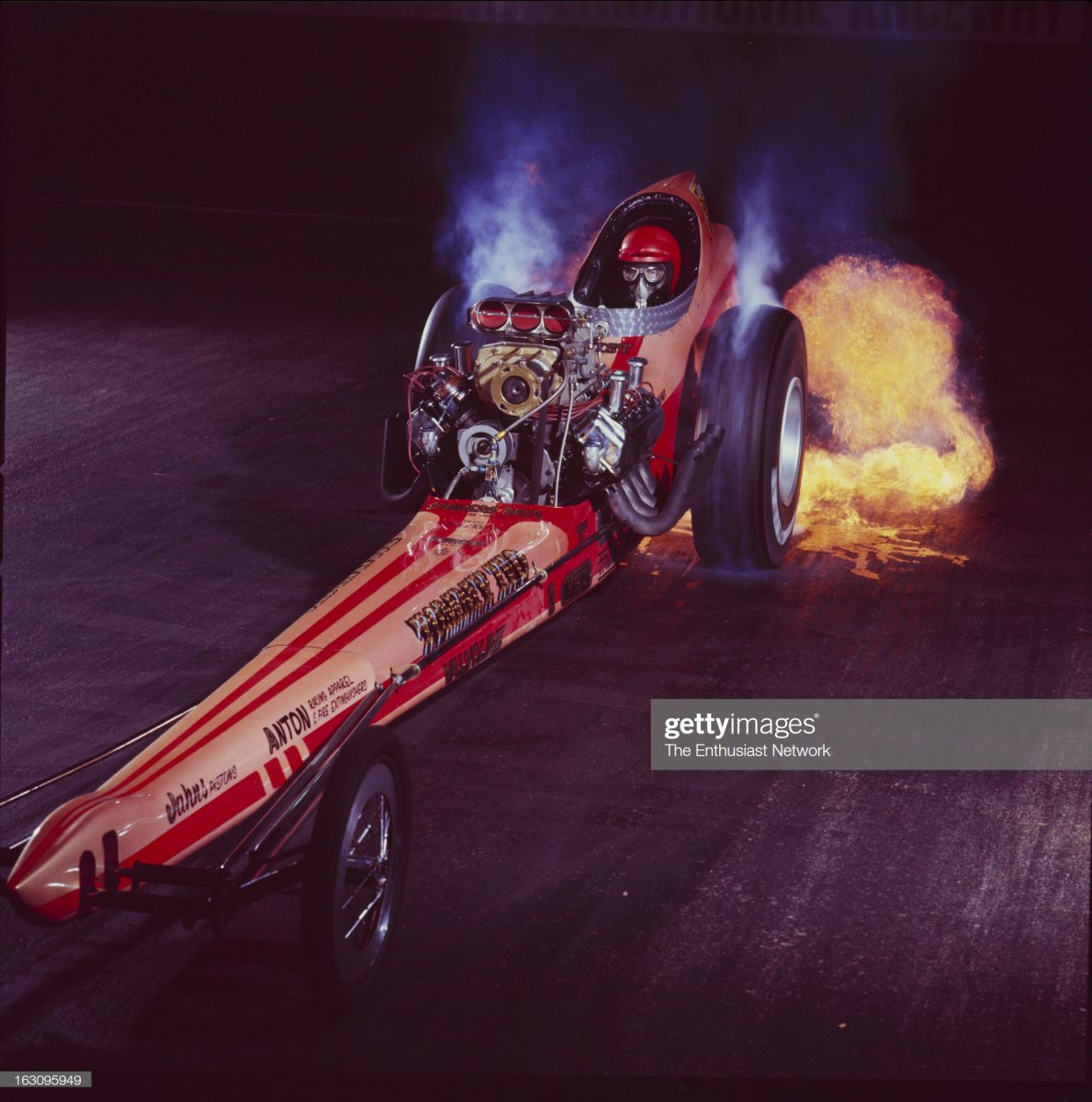 1  Tommy Ivo With Dragster. Tommy Ivo lights it up in his slingshot dragster1.jpg
