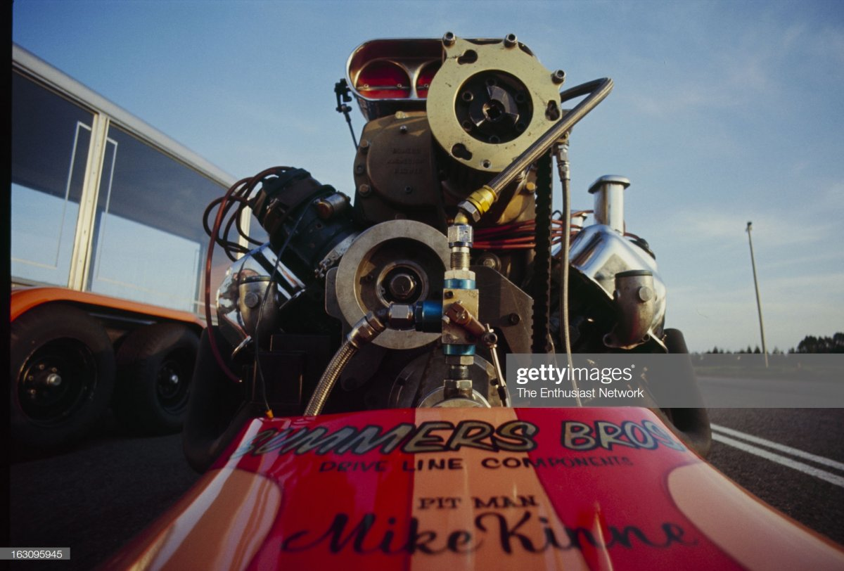1  Tommy Ivo With Dragster. Tommy Ivo lights it up in his slingshot dragster2 hemi.jpg