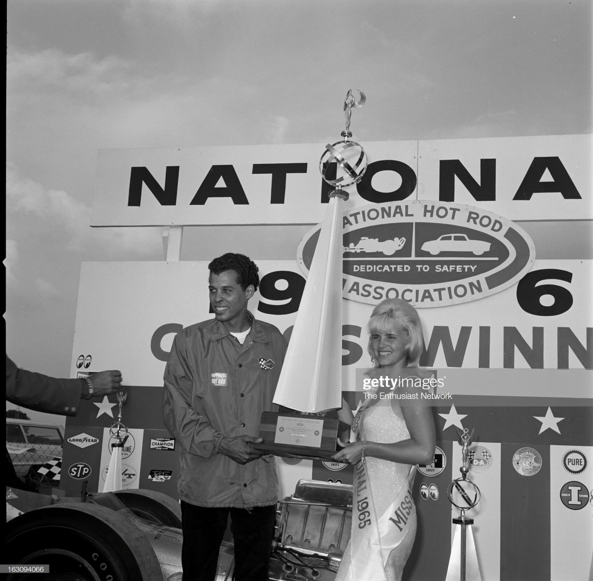 11 Miss Nationals 1965 presents the winner's trophy to driver Don Prudhomme.jpg