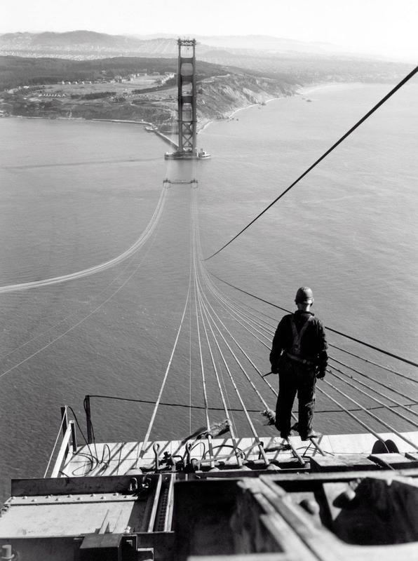 17 A man standing on the first cables.jpg