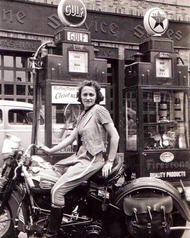 1941 motorcycle woman gas station.jpg