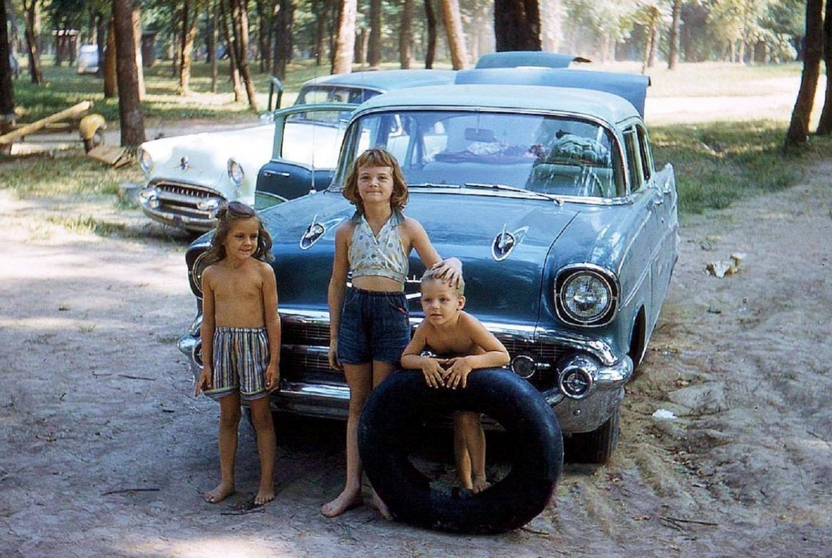 1957 Chevy 4 door kids with inner tube.jpg
