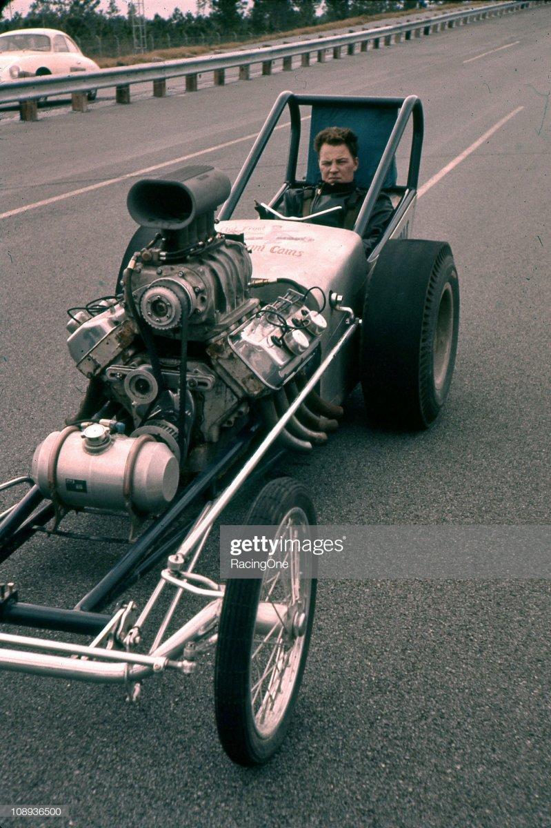 1961 A driver prepares for drag racink.jpg