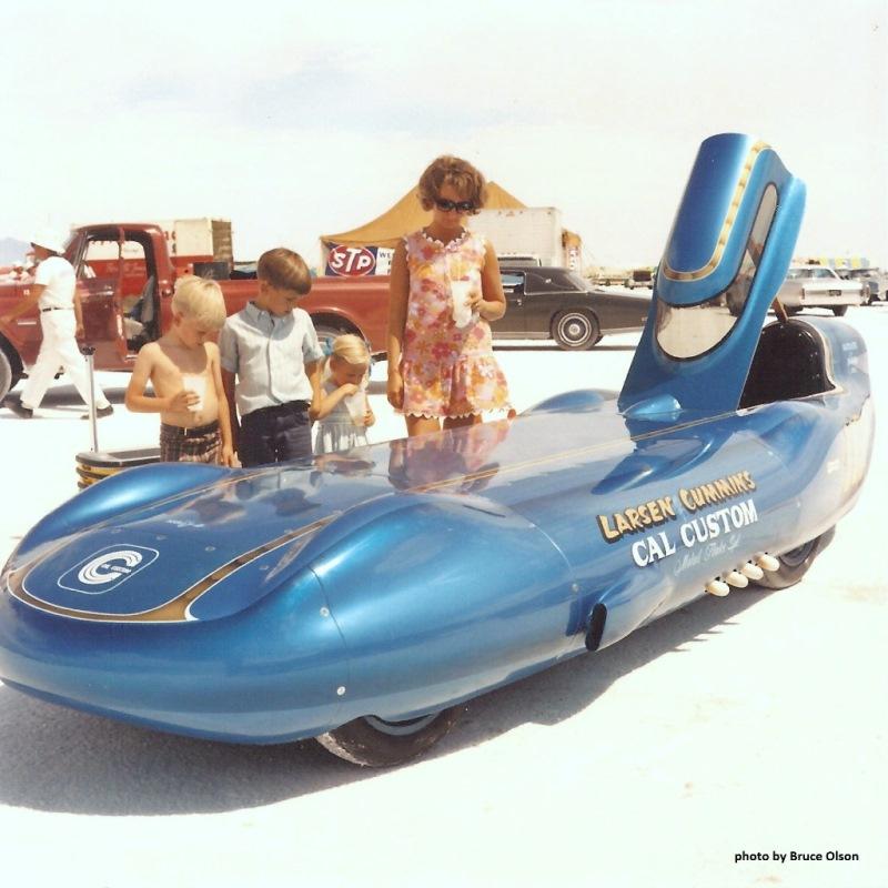 1970 - Mom & her kids with the Larsen & Cummins 'liner @ Speed Week.jpg