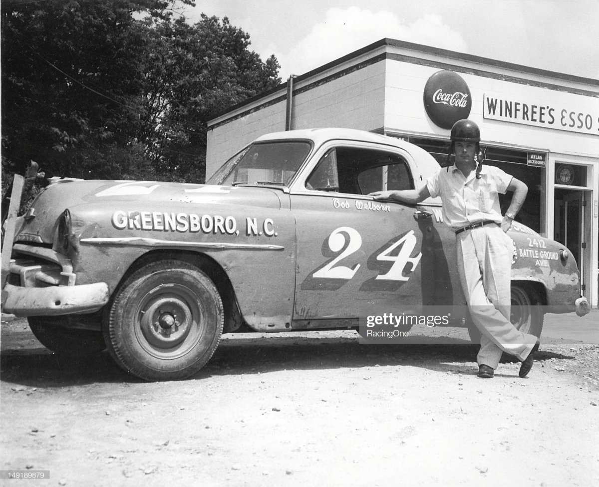 20  Bob Welborn with the Plymouth he drove on the NASCAR Cup circuit for car owner J. O. Goode.jpg
