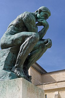 220px-Le_Penseur_in_the_Jardin_du_Musée_Rodin,_Paris_14_June_2015.jpg