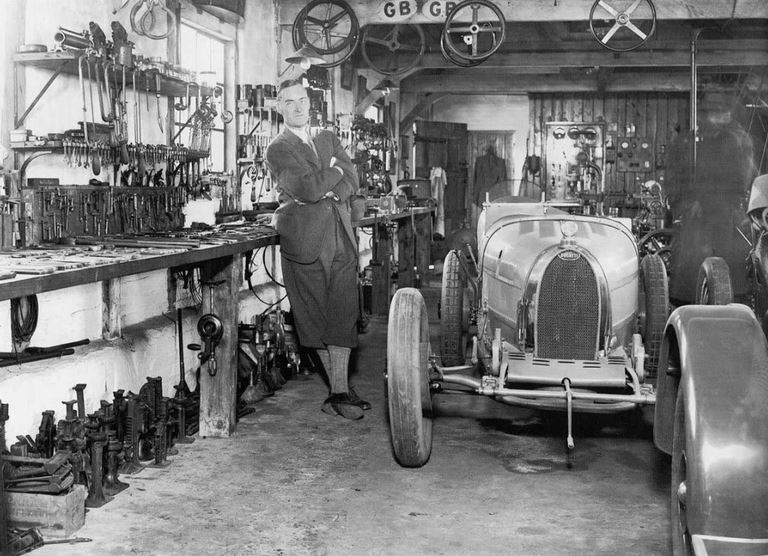 47 Famous record setter Sir Malcom Campbell with a Bugatti in a garage setting..JPG