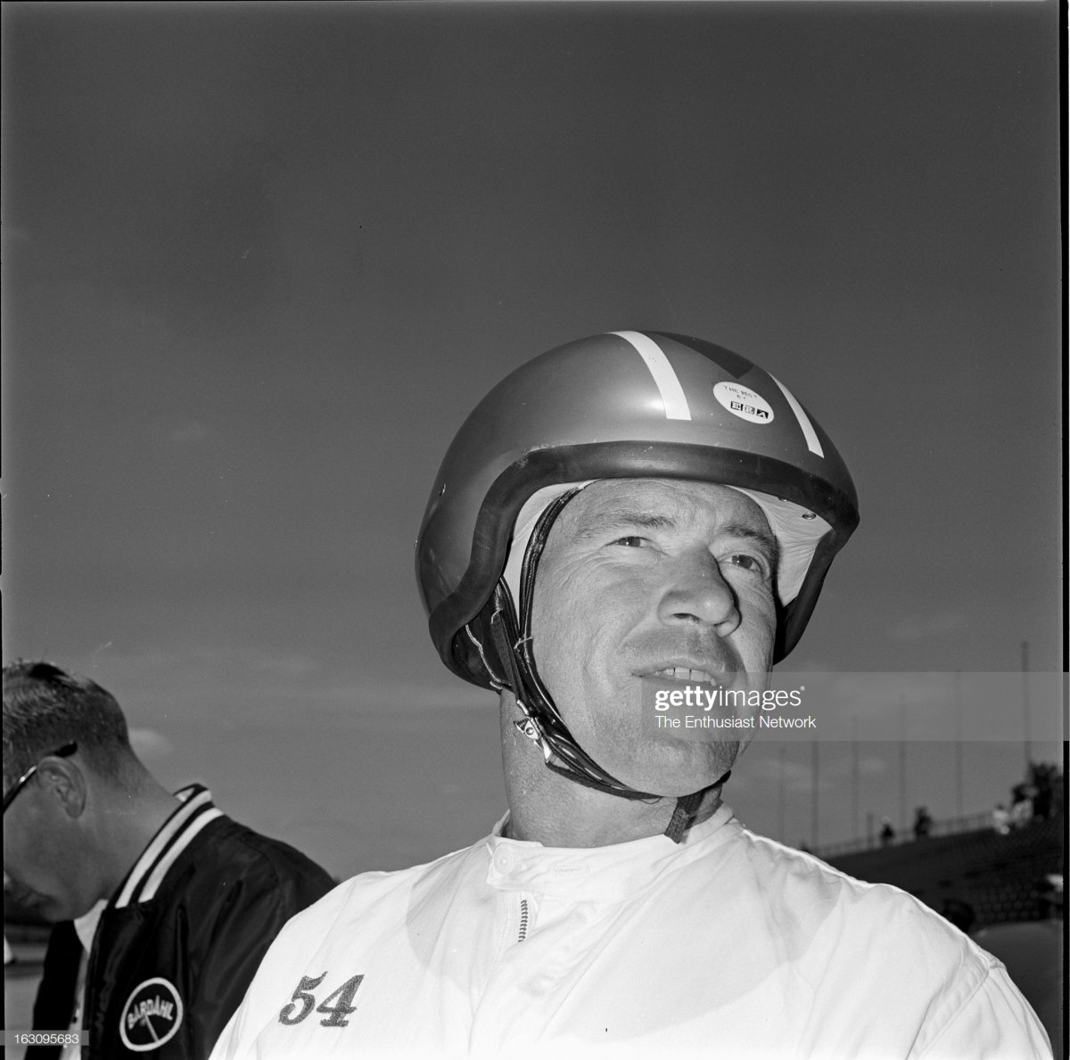 55 1965 Indianapolis 500. Driver Bob Veith stands around by the pits..jpg