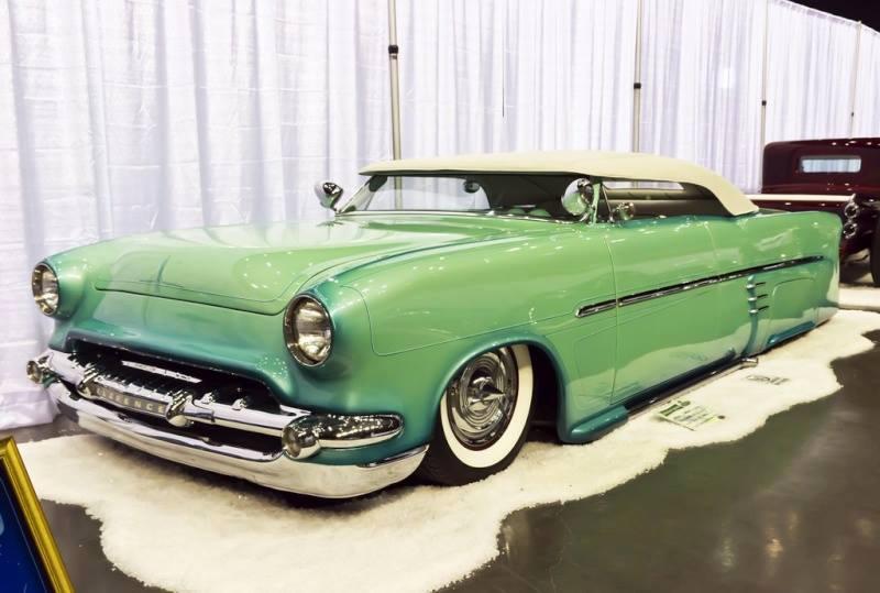 57 Chevy indoor show).jpg