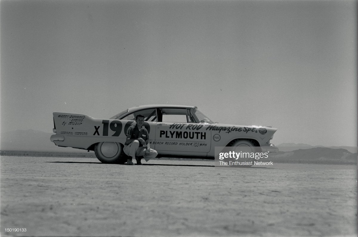 57 Dry Lakes Speed Trials. Wally Parks poses in front of Hot Rod M.jpg