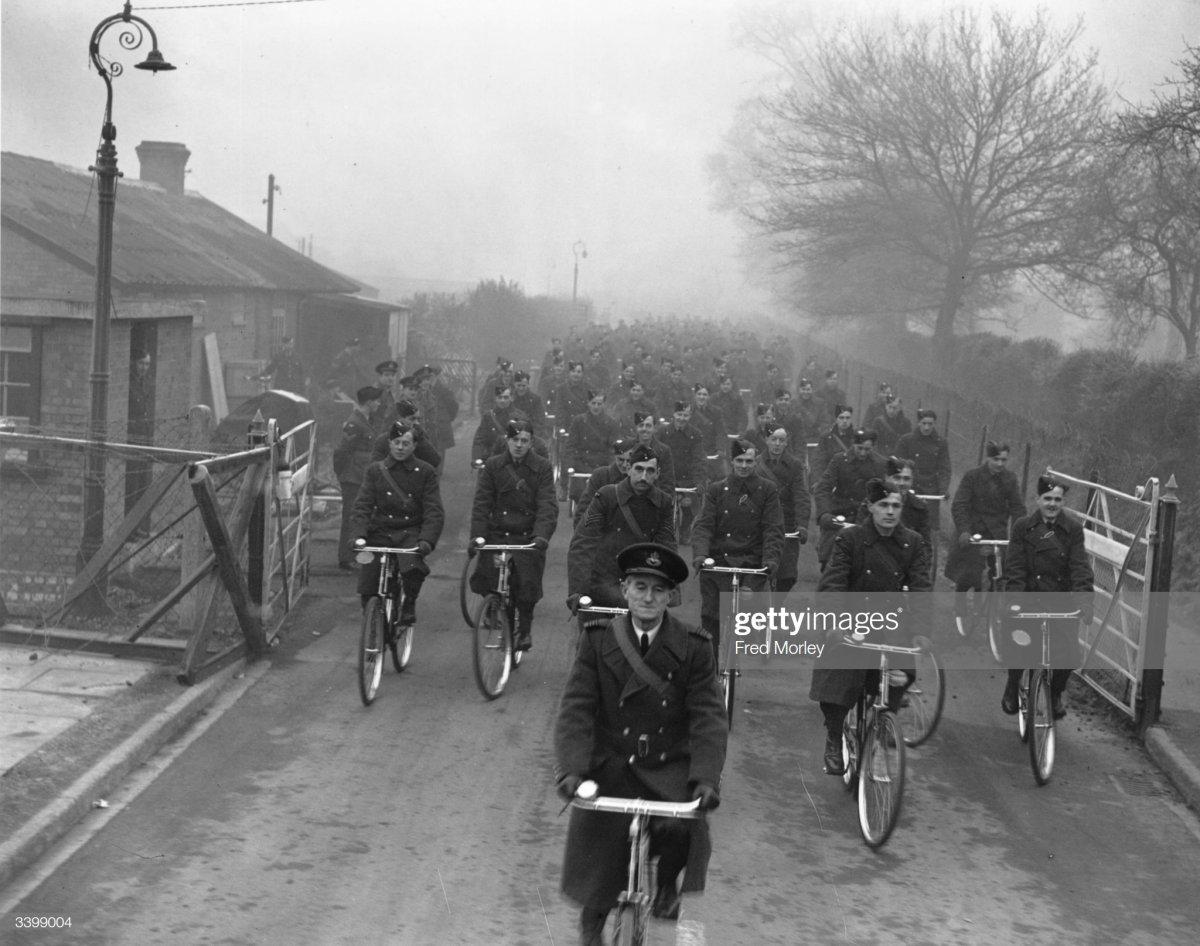 58 1941 RAF men leaving their station on bicycles.jpg