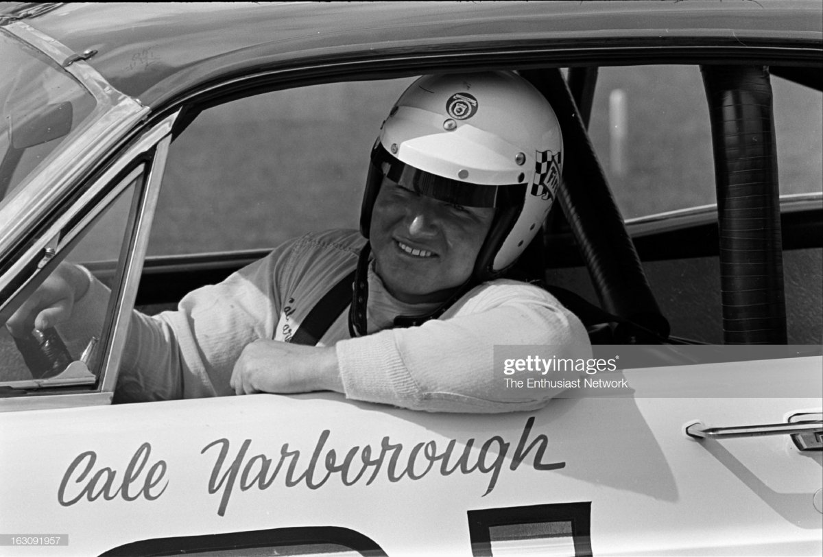 58 Daytona 500 - NASCAR. Cale Yarborough of the Wood Brothers team sits in his Ford..jpg