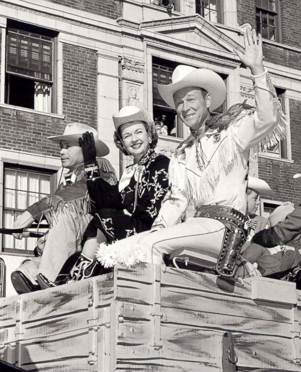 60 Roy Rogers and Dale Evans in a parade.jpg