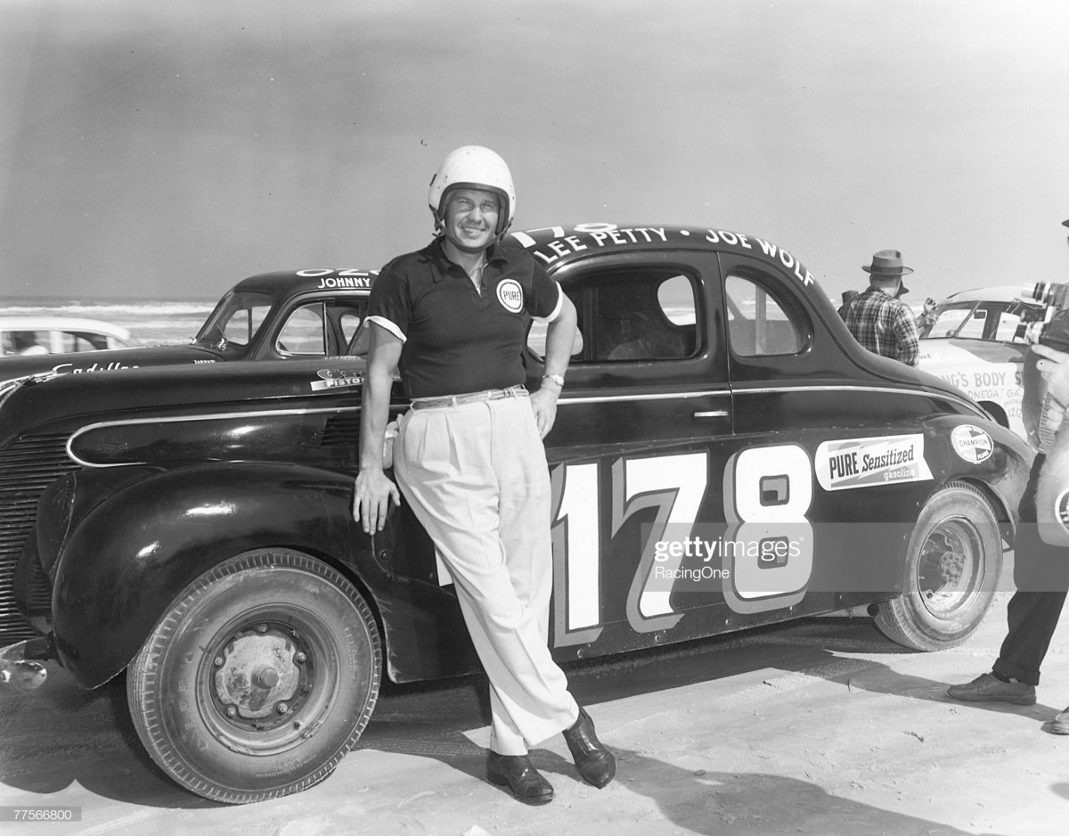 61 Lee Petty poses by his modified car on Daytona Beach, Florida on February 27, 1955.jpg