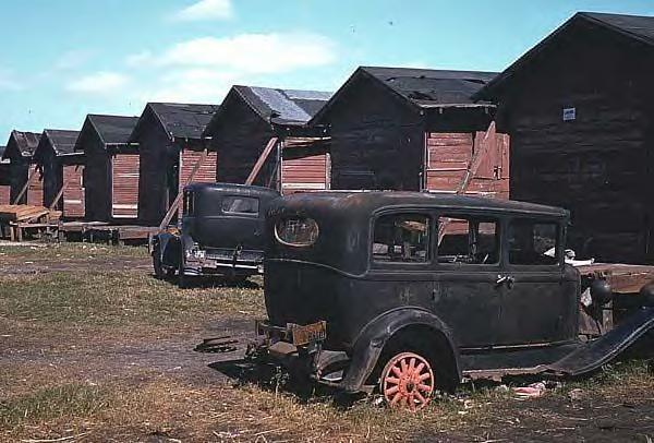 64 Broken down old cars by condemned houses of migrant farm workers 1941.JPG
