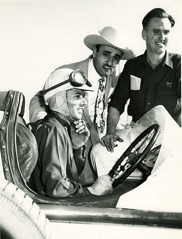 64 J.C. Agajanian, car owner and promoter, with Freddie Agabashian and Clay Smith..jpg