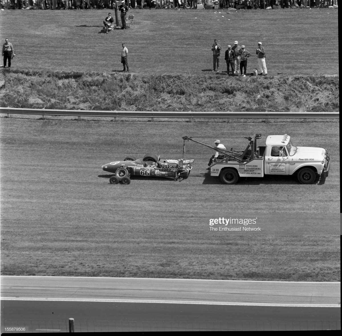67  Track crews tow away the remains of Cale Yarborough's Vollstedt 65.jpg