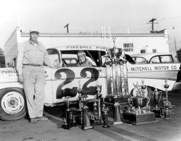 71 Fireball Roberts in his car parked next to trophies - Daytona Beach, Florida.jpg