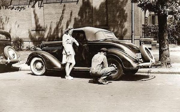 73 Changing tire for girl, Washington DC, 1942.JPG