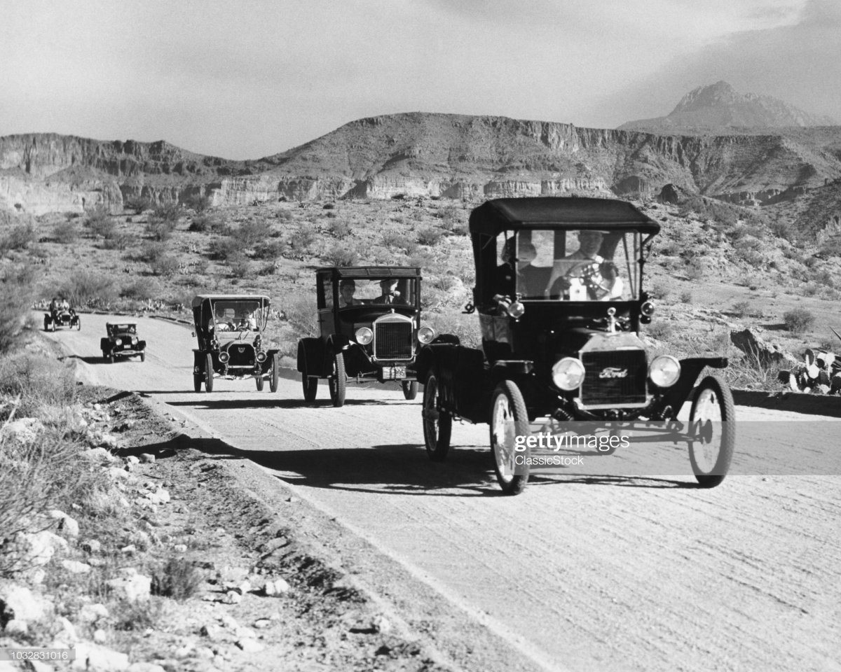75 1960s LINE OF 1920s MODEL T AND 1930s MODEL A FORD AUTOMOBILES.jpg