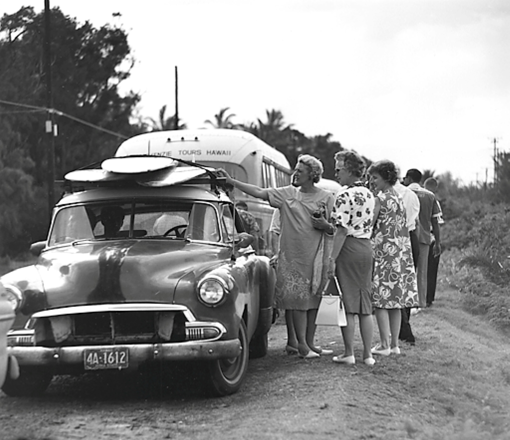 8_RC_Sunset_Beach_Tourists_Women_Looking_at_Surfboards_on_Car_1963.jpg