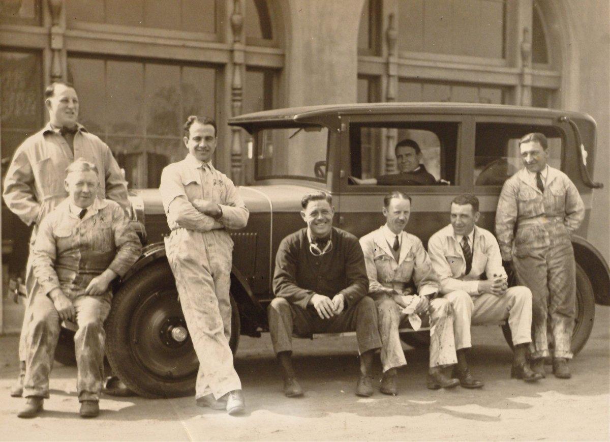 Augie-Duesenberg-Peter-Depaolo-and-crew-posing-with-model-a-sedan.jpg