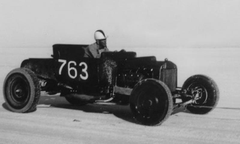 B'ville 1950 - Bob Estrada rides back to the pis in MacDonald & Lynde C Modified Roadster.jpg