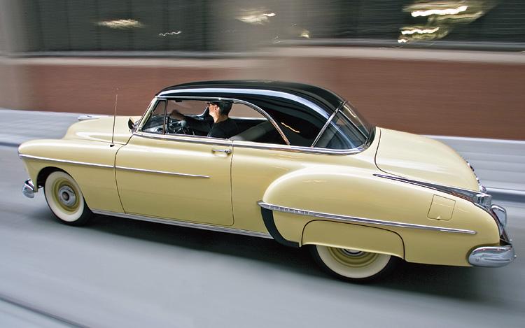 c12_0612_03z+1950_oldsmobile_futuramic_88+rear_side_driving.jpg