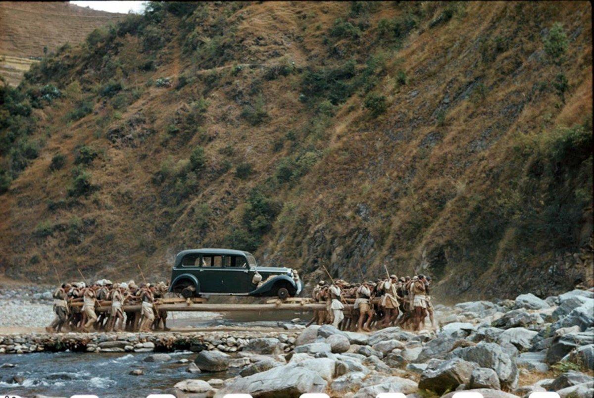 car on long poles across a stream in Nepal, 1948.jpg