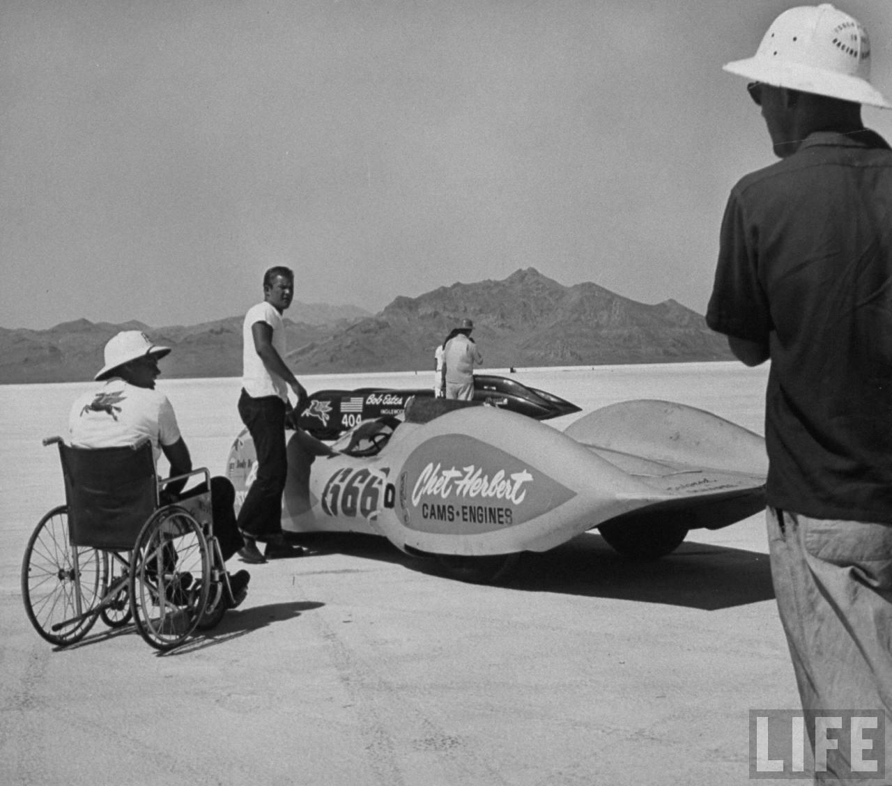 Chet Herbert (wheelchair) and his 'Beast 4' streamliner - 1953 photo by JR Eyerman .jpg