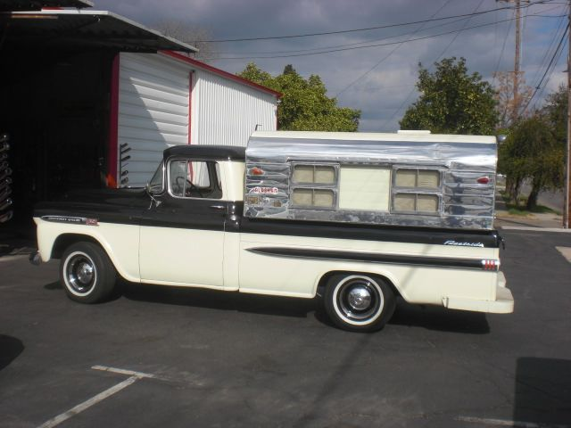 Chevy pickup with POLISHED Alaskan camper shell.jpg