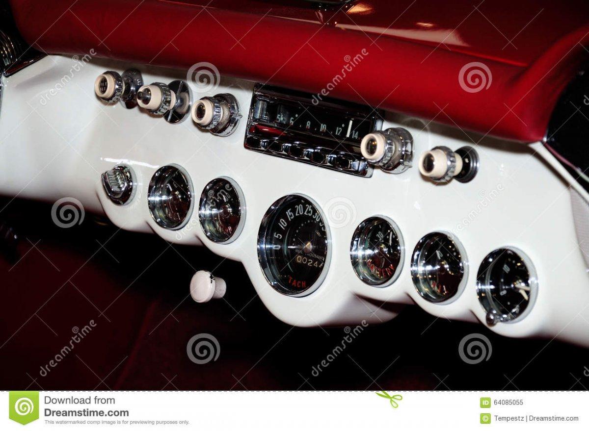 classic-car-dashboard-analog-displays-controls-white-red-64085055.jpg