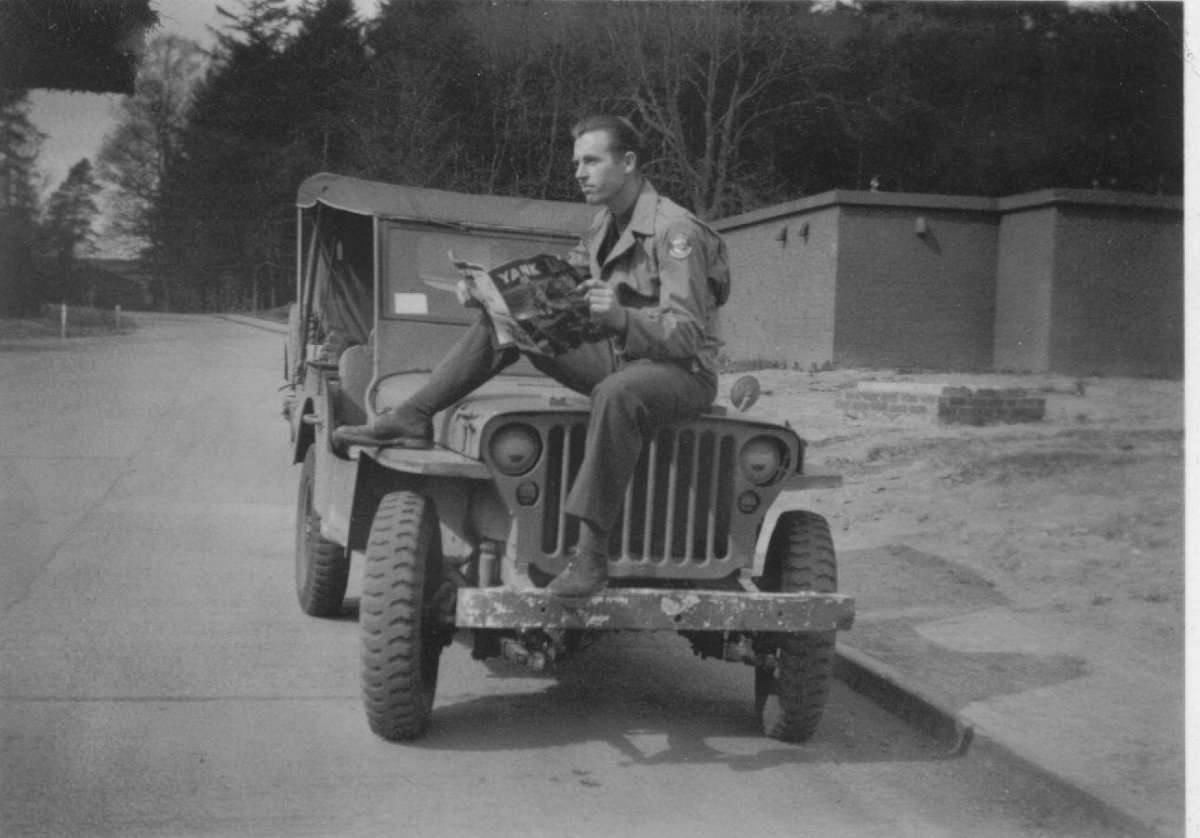 Dad sitting on a Jeep Ireland.jpg