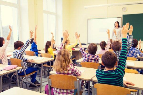 depositphotos_86538478-stock-photo-group-of-school-kids-raising.jpg