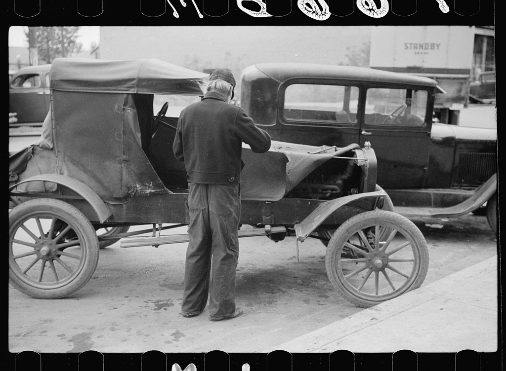 Farmer with 1913 model Ford on main street of Sisseton, South Dakota, 1939.jpg