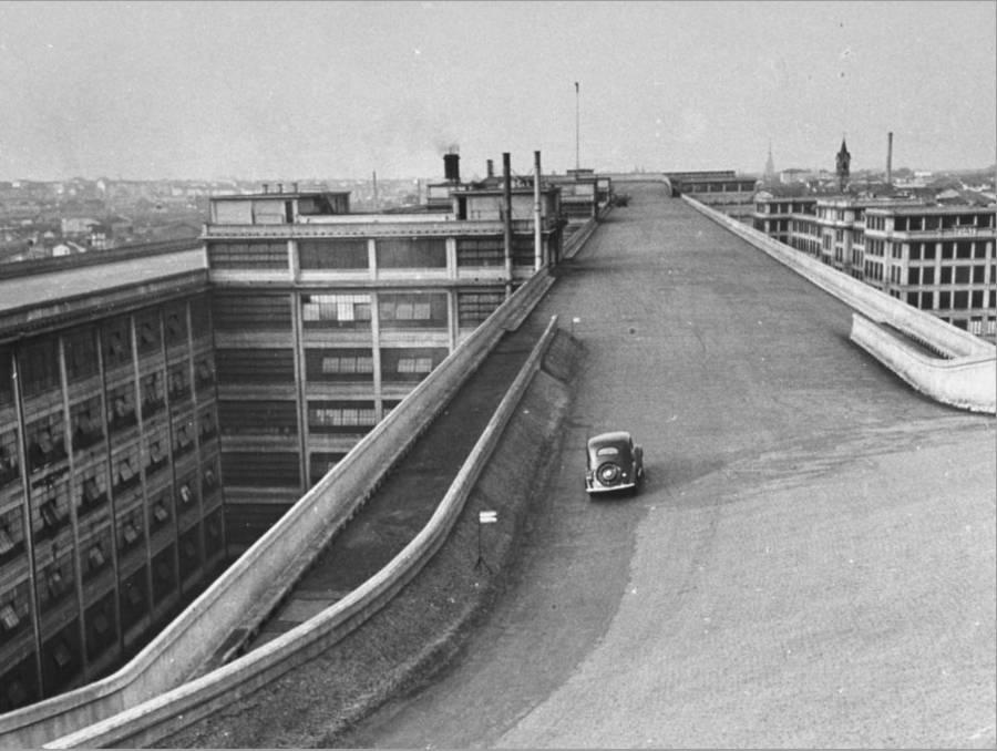 fiat-car-driving-along-the-desolate-street_u-l-p73149o1zln.jpg