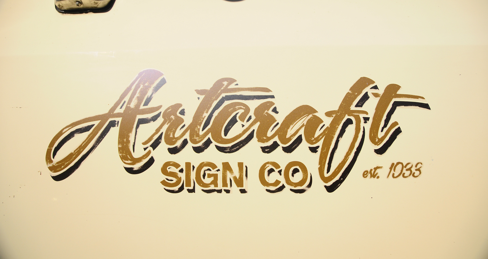 Hand lettered truck patina decal.jpg