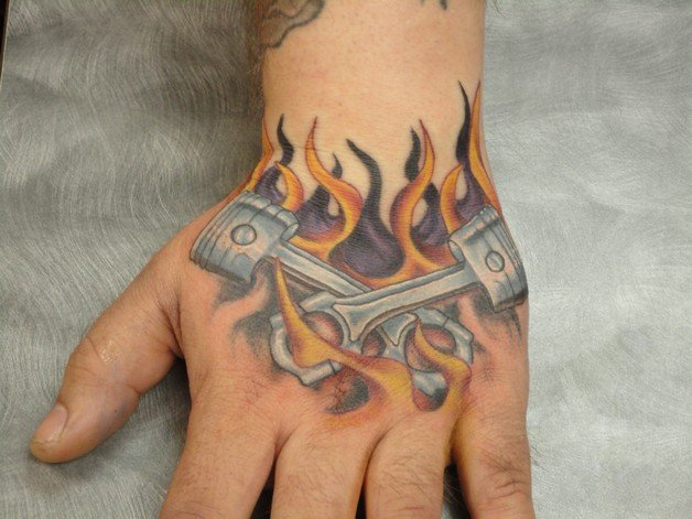 Hot-Rod-Pin-Up-Girl-And-Flames-Tattoos-On-Arm-1.jpeg