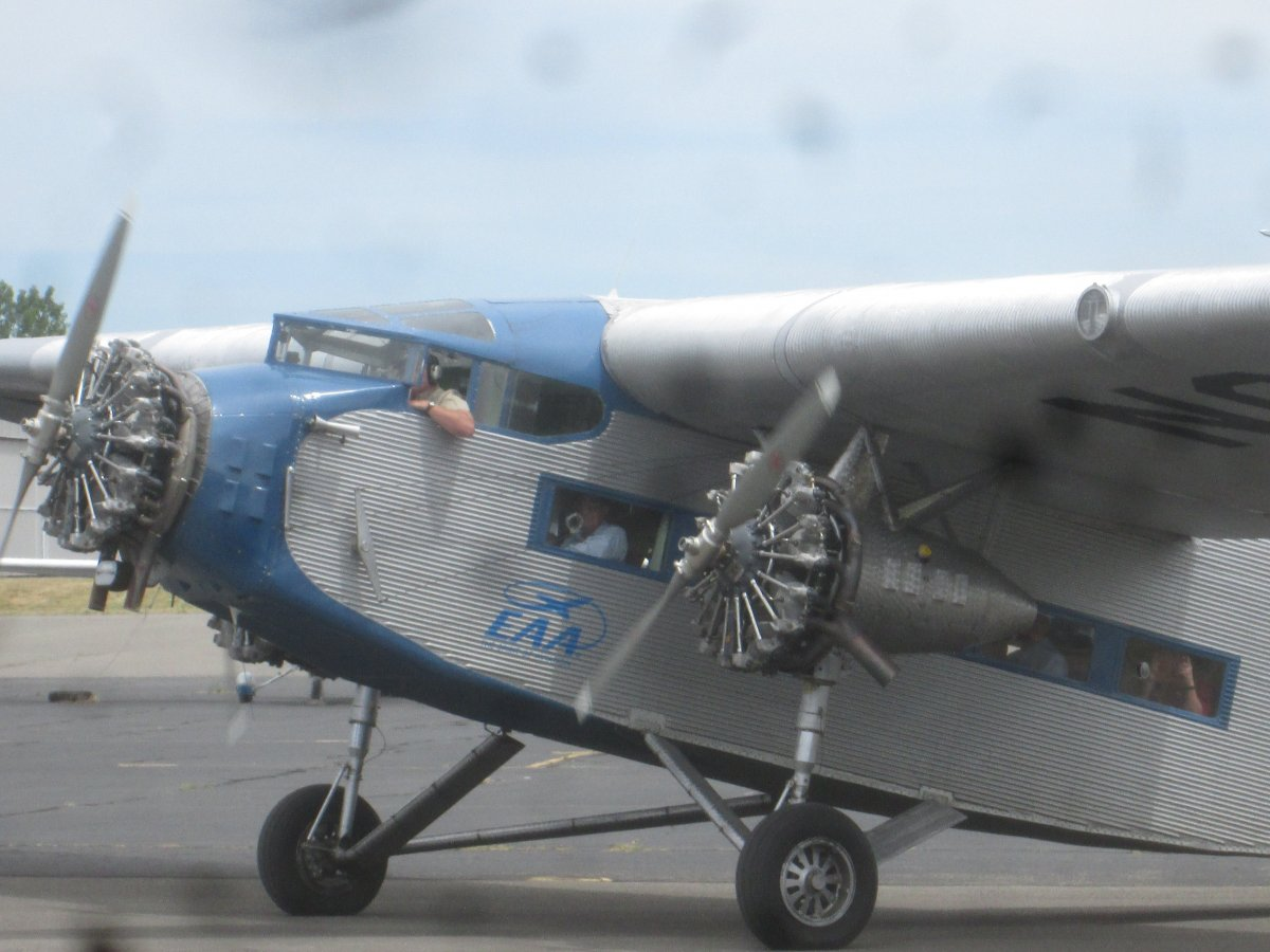 A ford trimotor plane moving freight and an incredible for Ford tri motor crash