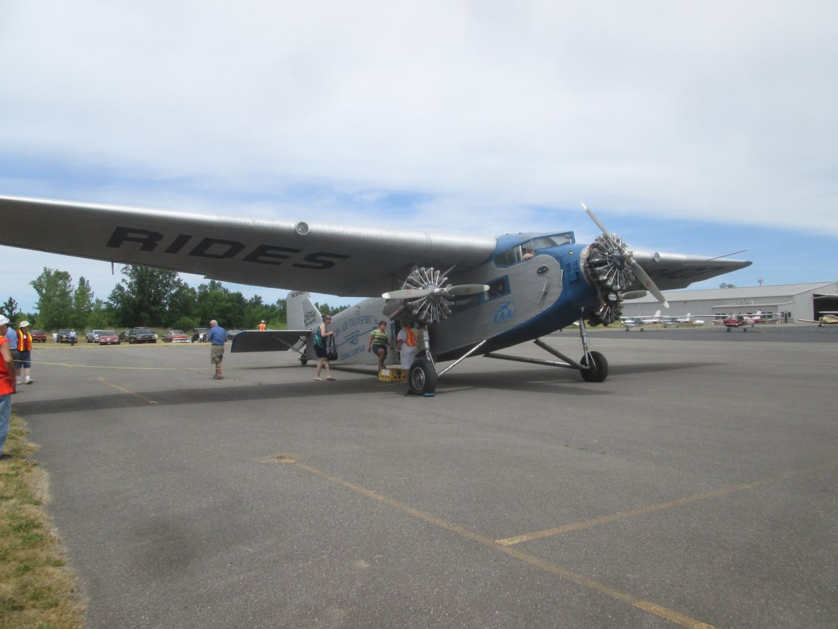 A Ford Trimotor Plane Moving Freight And An Incredible