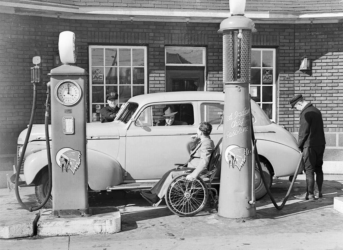 Jimmy Darou, paralyzed jockey, owned this service station, 1938b.jpg