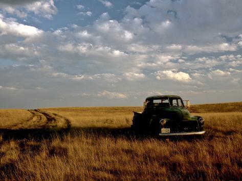kenneth-ginn-a-landscape-of-an-old-farm-truck-in-a-field-at-sunset.jpg