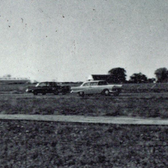 Late 1950s drag racing. That's Jack in the lead in his '57 supercharged Ford..JPG