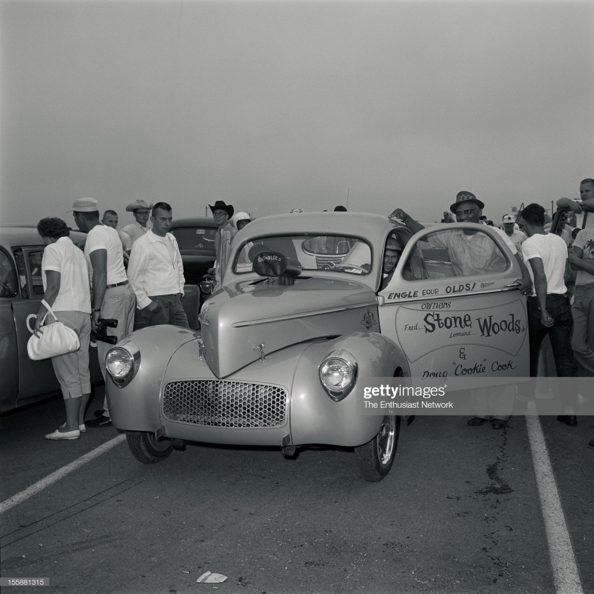 NHRA Indianapolis Nationals - 1962. Stone-Wood-Cook 1941 Willys Coupe in the staging lanes..jpg