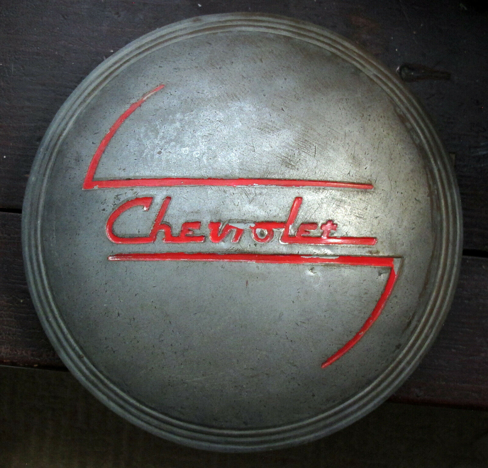 Old chevy hubcap with script.jpg