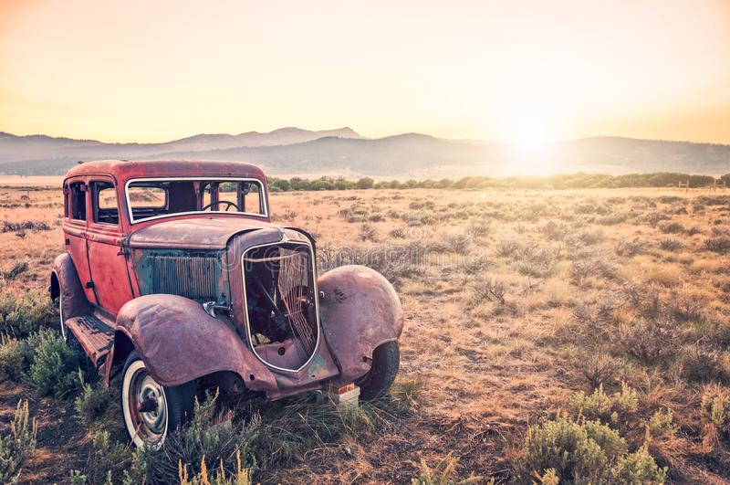 old-rusty-antique-car-abandoned-field-old-rusty-antique-car-abandoned-field-sunset-110827363.jpg