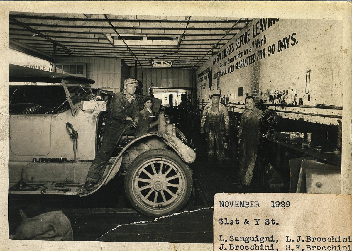 pop's shop 1929 with grand pa.jpg