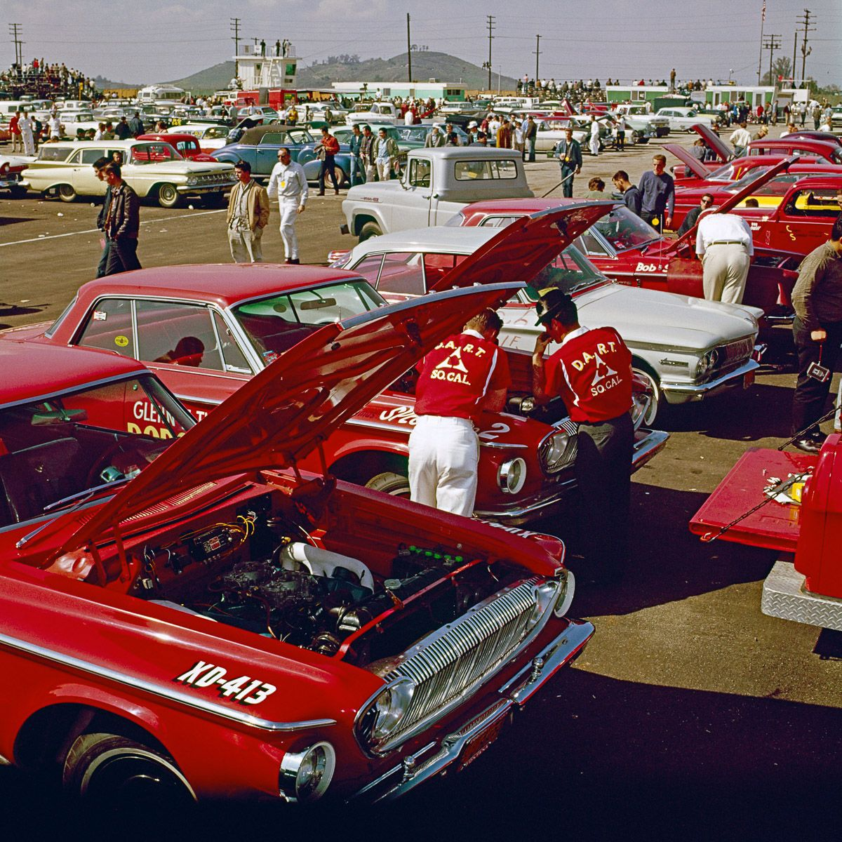 Racers work on a 1962 Dodge Dart in the pit at the NHRA Winternationals Drag Race..jpg
